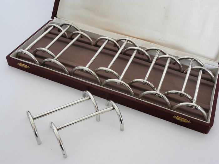 Set of 12 silver-plated Art Deco knife rests in a case