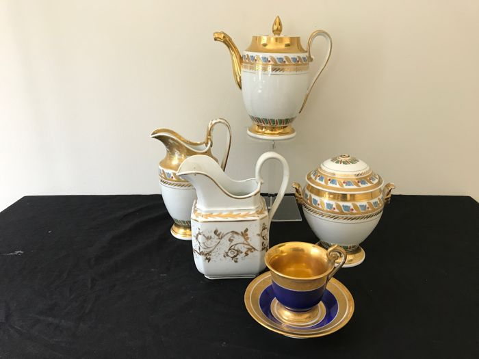 Porcelain Empire set, three pieces. France, first half of the 19th century, with two loose pieces in addition