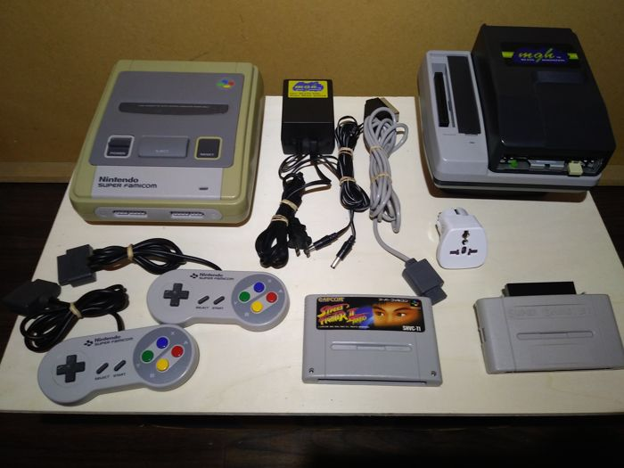 Japanese Nintendo Super Famicom console with multiple adapters + 1 game
