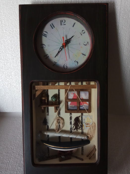 Antique clock with nautical motifs