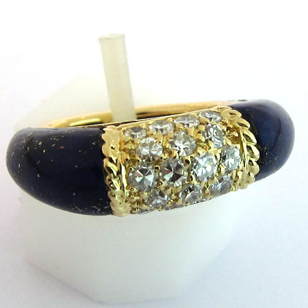 Philippine Van Cleef and Arpels (vca) ring in 24 kt gold with 18 diamonds of 0.10 mm, flanked by two lapis lazuli cabochons, size 48 weight 10.5 g, no resizing