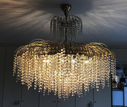 Large chandelier with crystal pearls. Features LED light