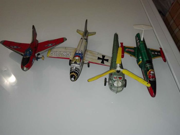 Lot of 4 tin friction A.M.B. Marchesini - 3 aeroplanes and 1 helicopter