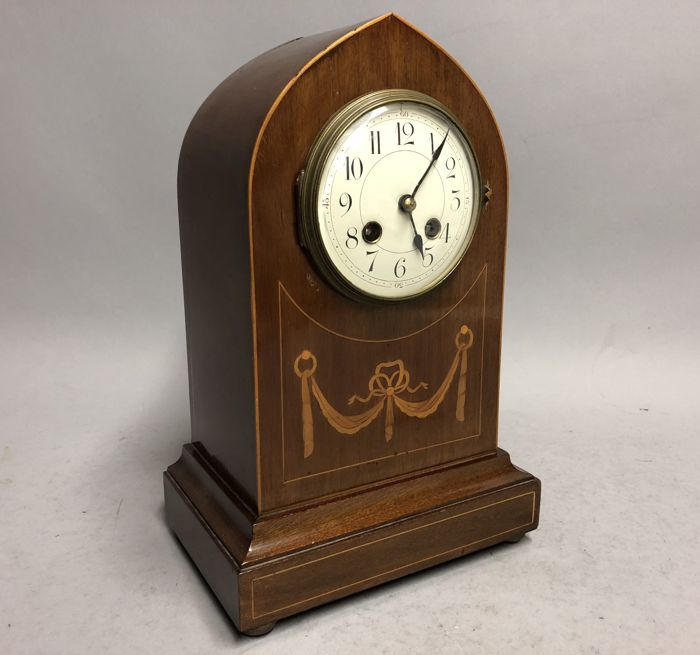 Mahogany wooden table clock with inlay of flowers and garlands