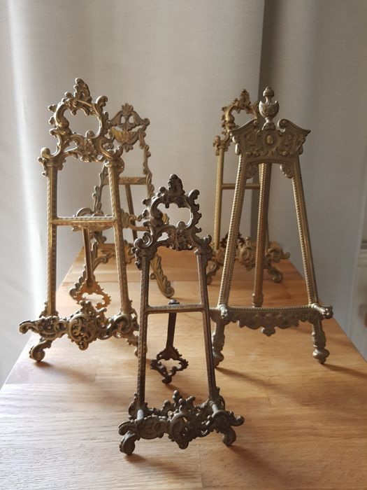 Five easels in gilded bronze