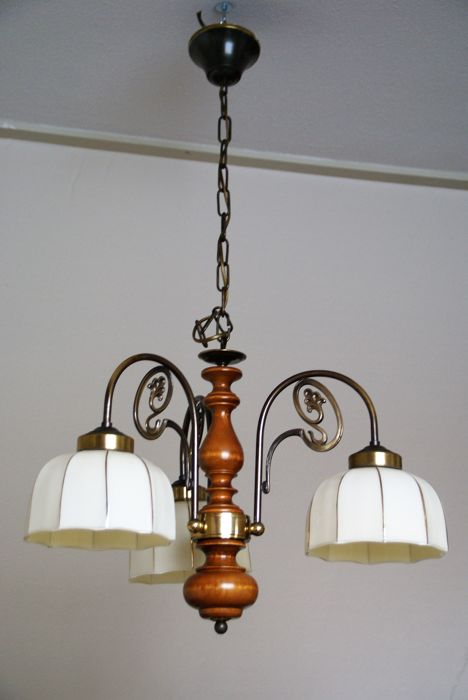 A room lamp that provides great atmosphere, is from 1960 with 3 octagonal glass lampshades