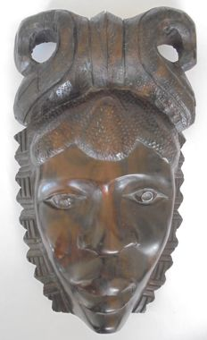 Decorative African wood warrior's mask. 20th century