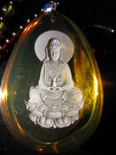 An important and rare Dominican blue Amber in top quality - Mother Buddha pendant- with an 18-inch top quality Cherry Amber chain.