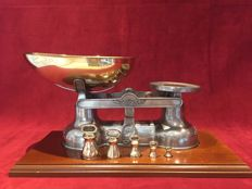 Exceptional pewter scale with brass weight collection