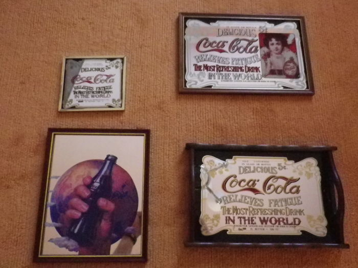 Lot of old Coca Cola mirrors