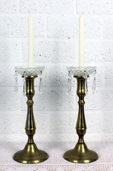 Pair of antique brass candlesticks with crystal drip trays and pendants