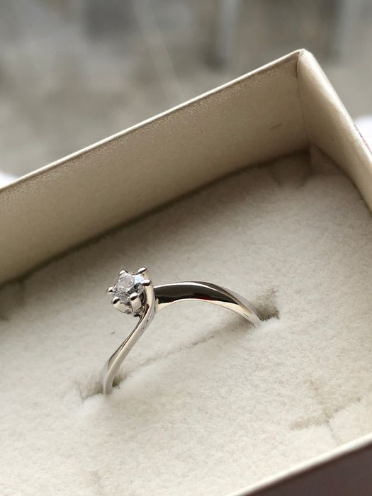 18 kt White Gold ring with 0.25 ct diamonds, size 15