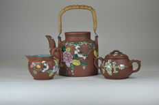 A set of Yixing clay teapot, sugar bowl, and creamer with a bird and peony in enamel – China – ca. 1940/50