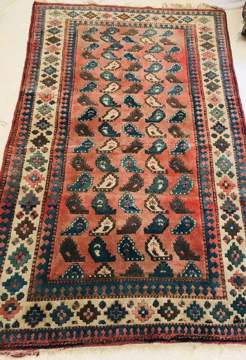 Antique hand-made carpet of approx. 210 x 140 cm