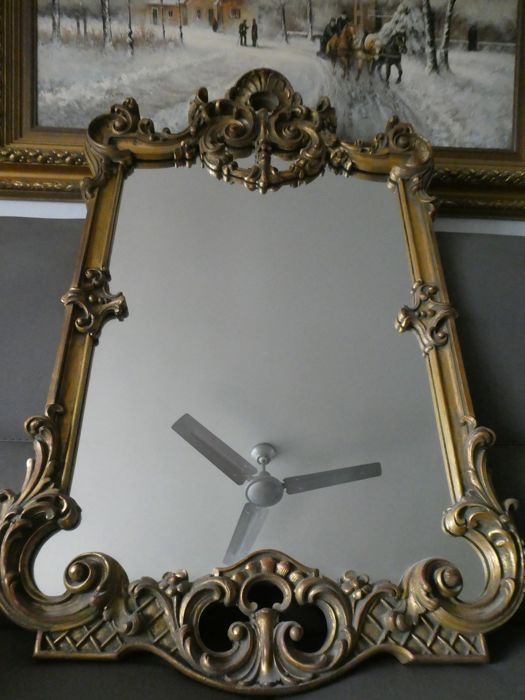 Mirror with graceful frame