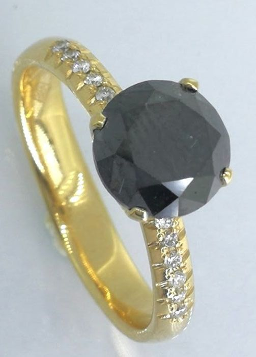 Ring with a 2.35  ct black diamond total & 12 white diamond ***no reserve price***