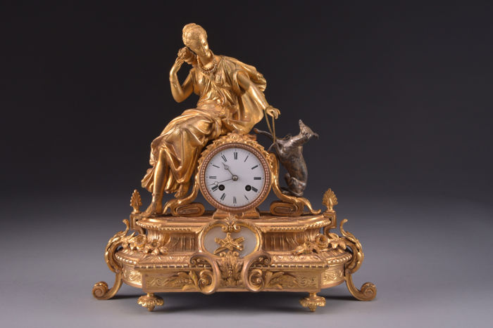 Wonderful, gold plated clock - beautiful image of a lady with her dog - movement Japy Freres med. d'honneur - France, around 1855