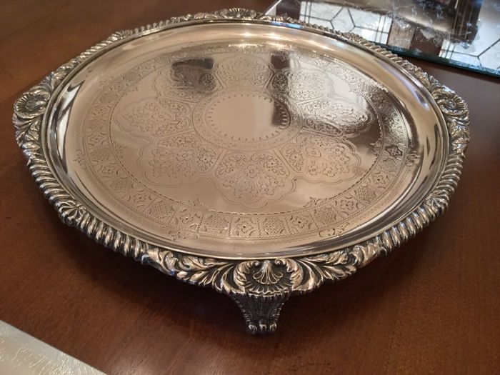 Round, silver plated and decorated serving tray with studs, by Martin Hall