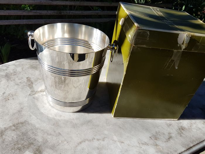 heavy champagne bucket in its pouch and case, by Luc Lanel for Christofle brand
