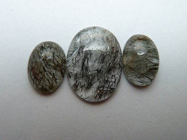 Three rutilated quartz stones - 15.45 ct