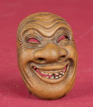Ceramic netsuke mask - signed - Japan - second half of the 19th century