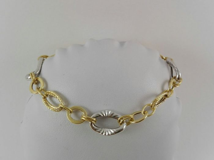 "18 kt yellow and white gold women's bracelet by ""Cerini"" Weight: 4.5 g"
