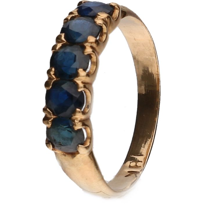 18 kt Yellow gold memoir ring set with blue sapphire Size: 17 mm