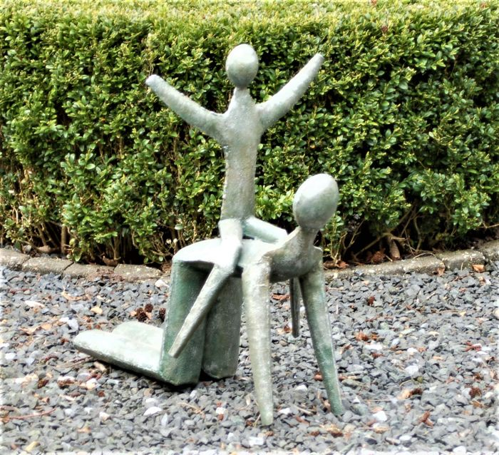 Metal sculpture of a father and child, from the 1970s - the Netherlands