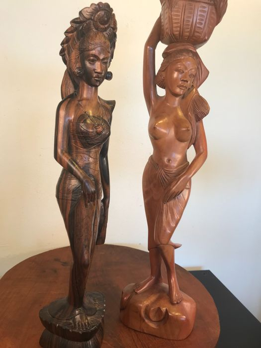 Two large wooden statues of stylish young women - Bali - Indonesia - 1960