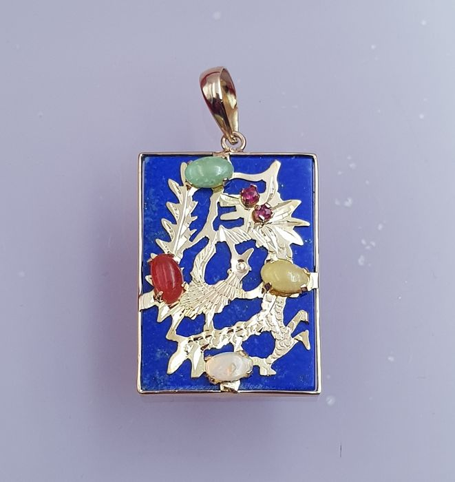 Original pendant in 18 kt Gold made with a large lapis lazuli as base of Chinese dragon which incorporates 2 opals, natural jadeite amber, and 2 small rubies