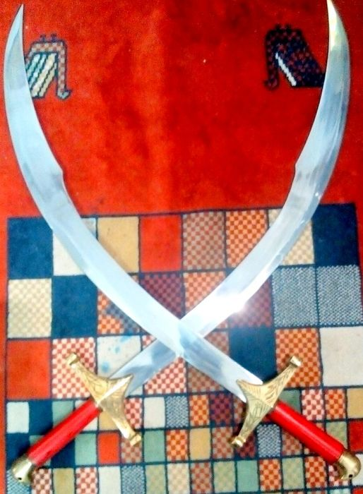 A collection of 2 Turkish Belly Dancing Swords, perfect balance, decorative product. 66 cm curved blade.