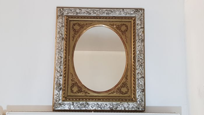 Oval mirror in wooden frame with rose decoration, silvery and gilded, mid 19th century
