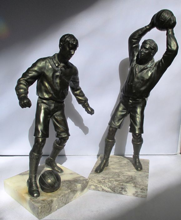 Two bronze plated, zamak/regule sculptures, football players on a marble base - early 20th century