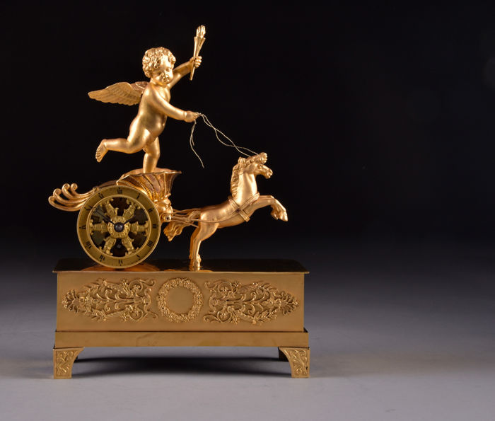 "Spectacular miniature fire-gilt bronze ""chariot"" pendulum clock with console and bell jar- with putti chariot and two horses- France around 1800"