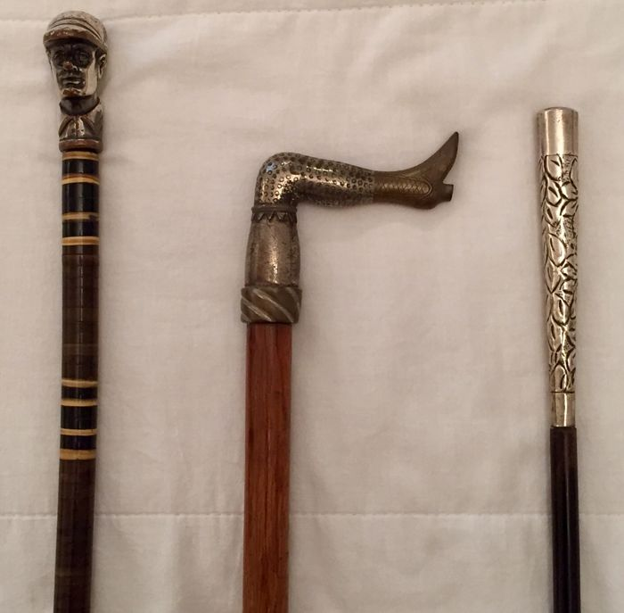 Three walking sticks, wood and silver 800/silver metal/metal and bronze -Italy - early 1900s