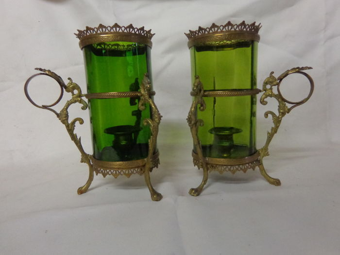 Pair of candlesticks in dragon motif with green glass, circa 1900