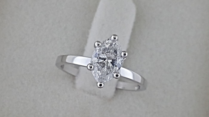 0.92  ct D/SI1  marquise diamond solitaire ring 14 kt gold - size 5.5