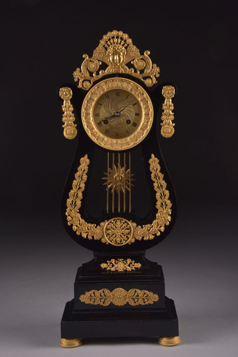 Impressing large (55 cm) black wooden Lyre pendulum clock with finely decorated fire-gilt ornaments- Frrance, approx, 1820