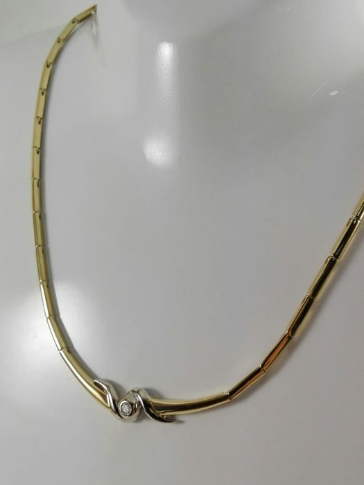 Women's semi-rigid necklace in 18 kt yellow and white gold with 0.08 ct natural diamond  Weight 20.3 g