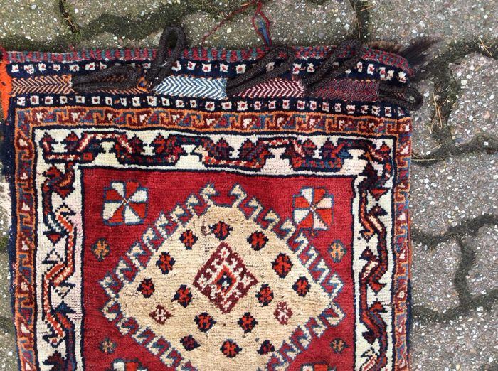 Camel bag and three hand-knotted carpets
