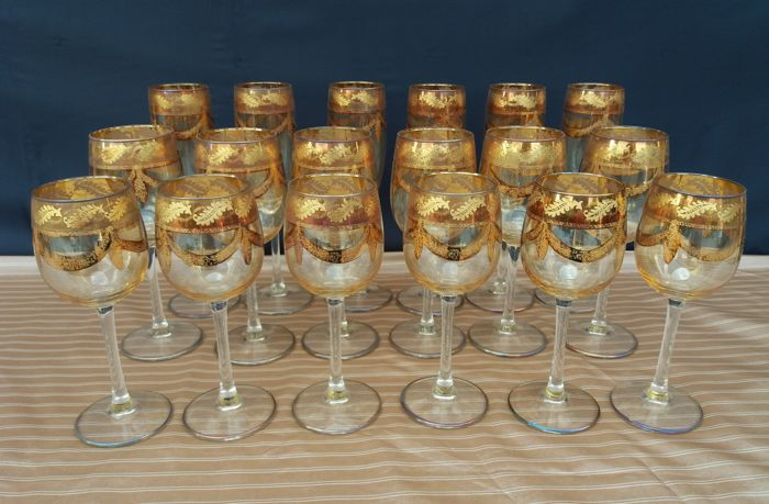 Service set of 18 crystal glasses with gold trim