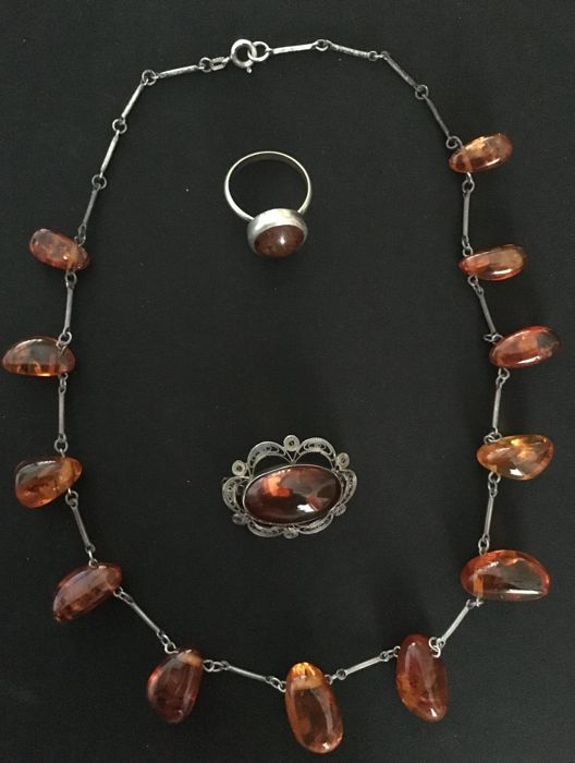 Antique amber, ring, brooch, and necklace, silver 800, 29.67 g