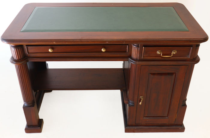 A compact mahogany desk with imitation leather top, ca. 1995, Netherlands