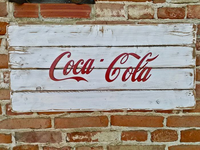 Decorative wooden board with Coca-Cola metal lettering