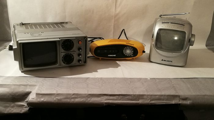 Two portable TVs from the 1970s and a vintage radio very