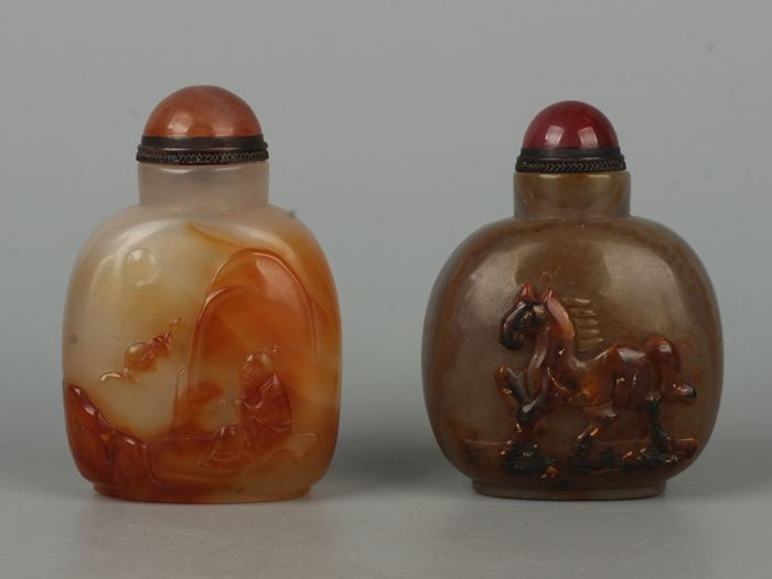 Two Chinese agate/ carnelian snuff bottles carving a old man or a horse -- 96g and 107g - China - second half 20th century