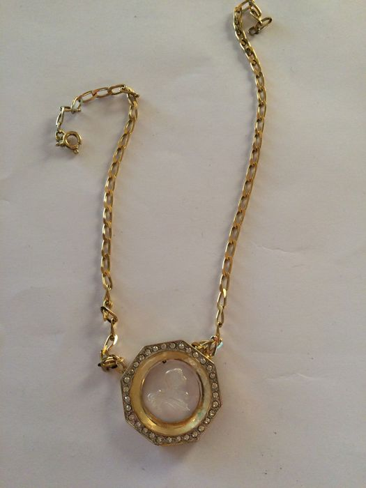 Golden silver necklace with crystal pendant