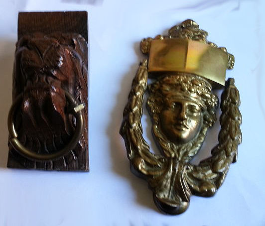 A hardwood door knocker and brass knocker