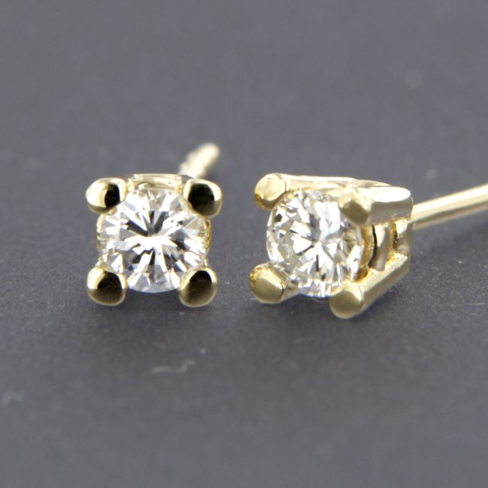 14 kt yellow gold solitaire ear studs set with brilliant cut diamond approx. 0.32 carat in total
