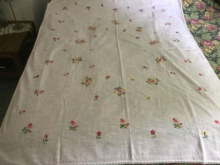 Beautiful hand embroidered flowers on linen tablecloth